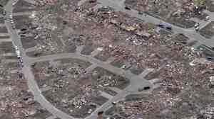 An aerial view shows an entire neighborhood destroyed by Monday's tornado in Moore, Okla.