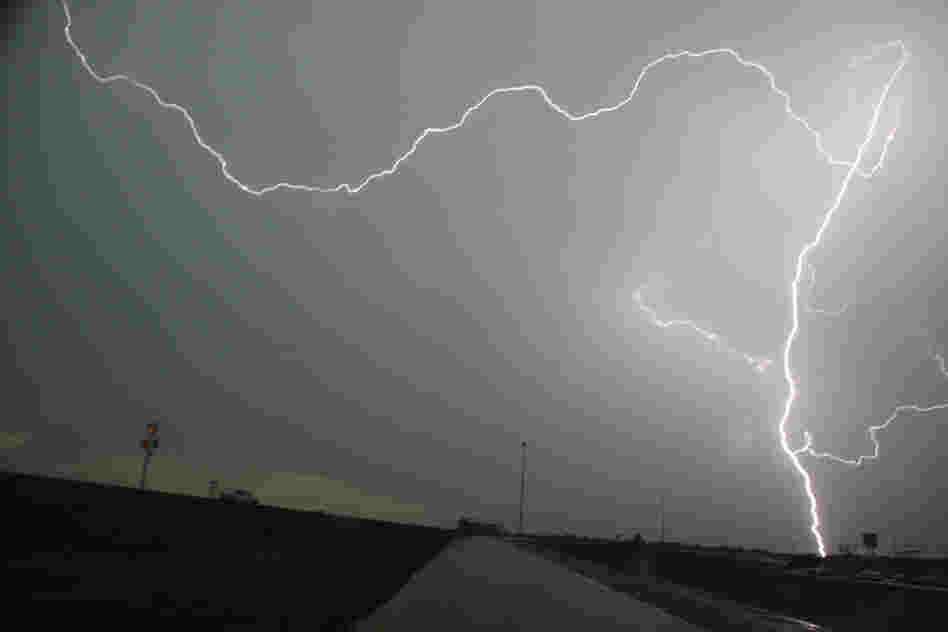 Lightning strikes over interstate 35 near Moore on Tuesday. Thunderstorms and lightning slowed the rescue effort on Tuesday, but more than 100 people had been pulled from the debris alive.