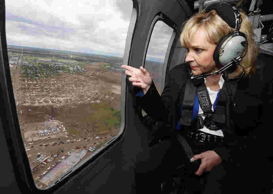 Oklahoma Gov. Mary Fallin looks out the window of a National Guard helicopter as she tours the tornado damage in Moore, Okla., on Tuesday.