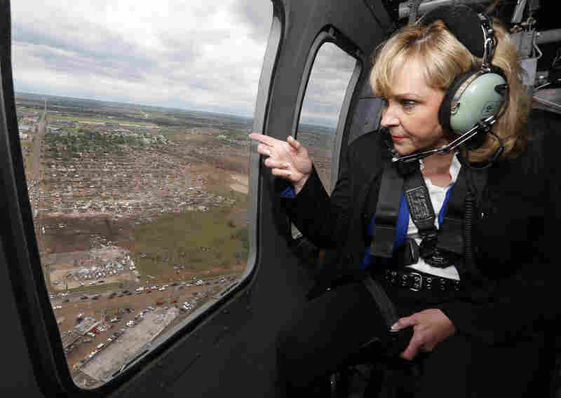 Oklahoma Gov. Mary Fallin looks out the window of a National Guard helicopter as she tours the tornado damage Tuesday.