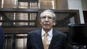 Guatemala's former dictator Efrain Rios Montt arrives in court Jan. 31 in Guatemala City to stand trial on genocide charges. On Monday, his conviction was overturned.