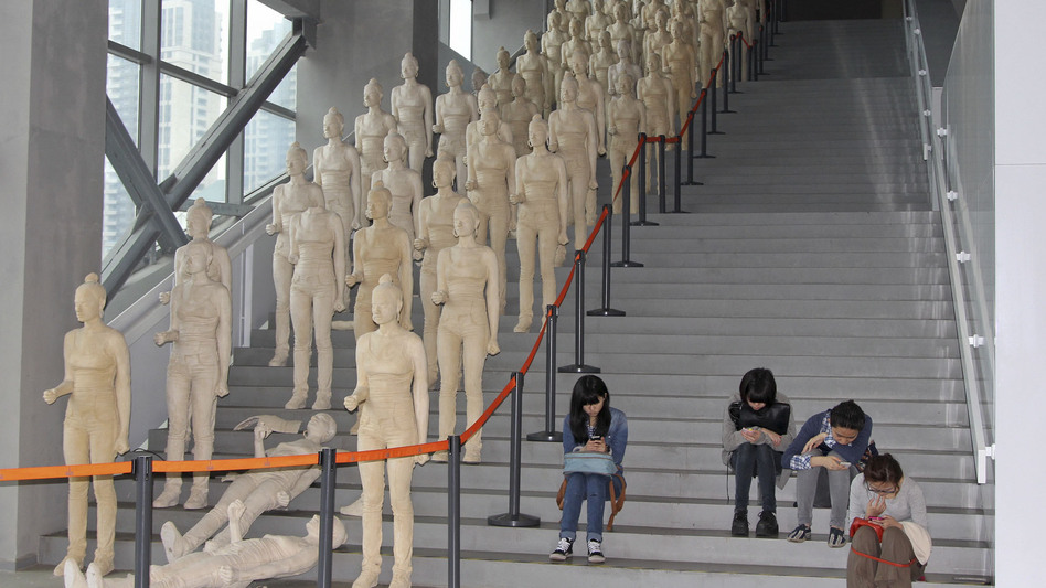 Young museum-goers at the Power Station of Art check their smartphones. Engaging audiences is challenging in China, where there is no emphasis on art education in public schools.