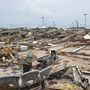 An Emotional Gauntlet: Tornado Survivors Start Picking Up The Pieces
