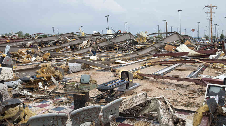 The destruction was wide and devastating in Moore, Okla., on Monday after a tornado roared through.