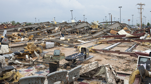 The destruction was wide and devastating in Moore, Okla., on Monday after a tornado roared through. (Reuters /Landov)