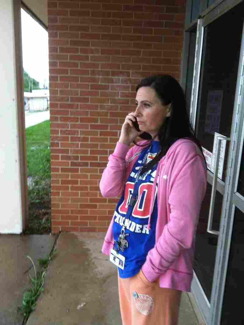 Suzanne Sells, a special education English teacher at Moore High School in Moore, Okla., stayed with her students through Monday's tornado though for some time her own daughter's fate was unknown.