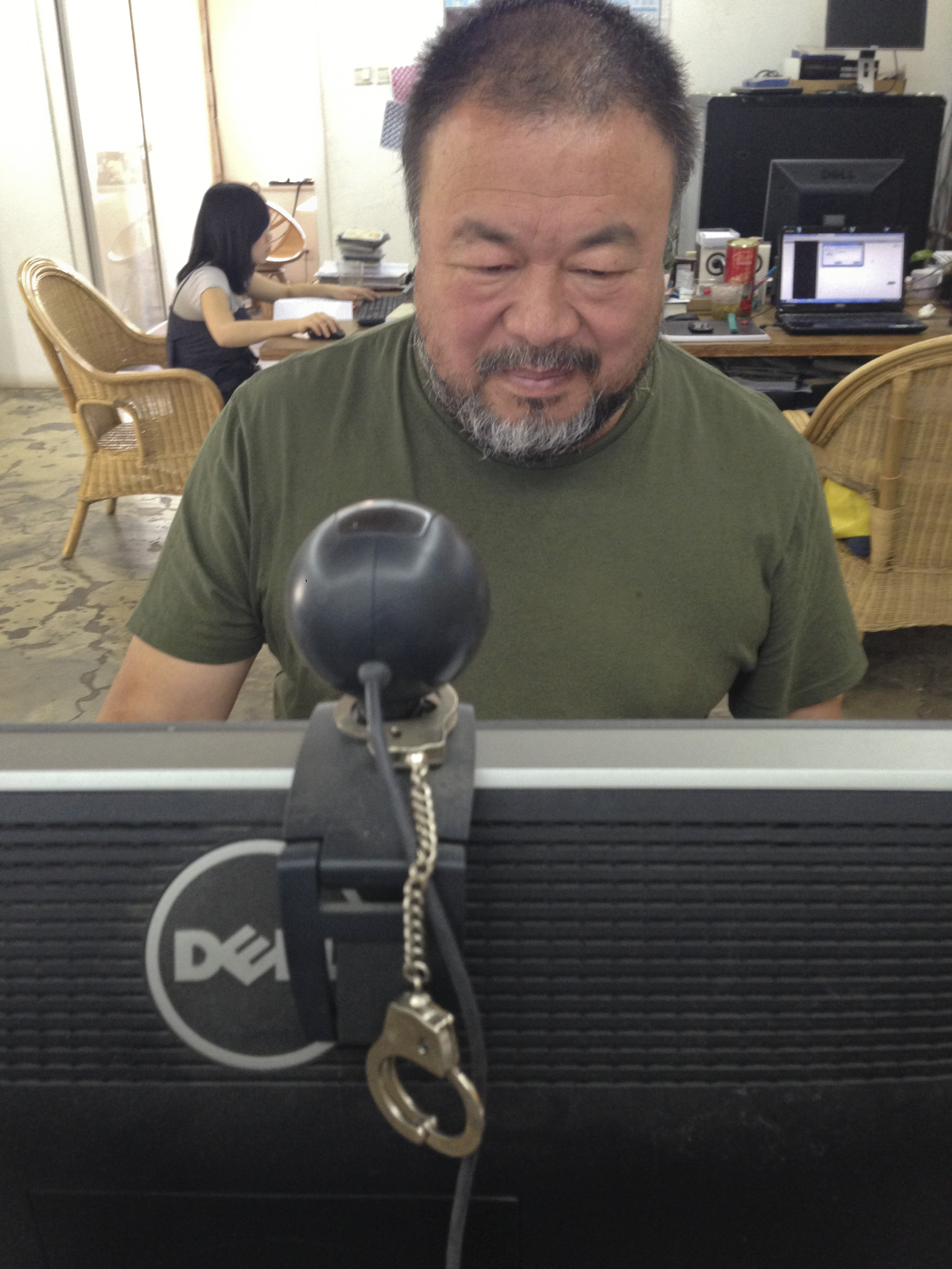 Ai Weiwei monitors the reaction to his new song on Twitter on Wednesday, the day the song was released.