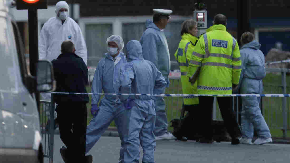 Police and forensic officers near the scene of Wednesday's brutal attack.
