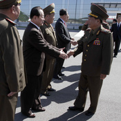 North Korean party and military official Choe Ryong Hae, (front right), shakes hands with as he departs for China.