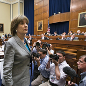 Lois Lerner, head of the IRS unit that decides whether to grant tax-exempt status to groups, leaves after being dismissed from a House Oversight and Government Reform Committee hearing on Wednesday.