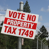 A yard sign yard sign opposes  a local tax increase to fund public safety in Josephine County, Oregon. The ballot measure reportedly failed by a thin margin.