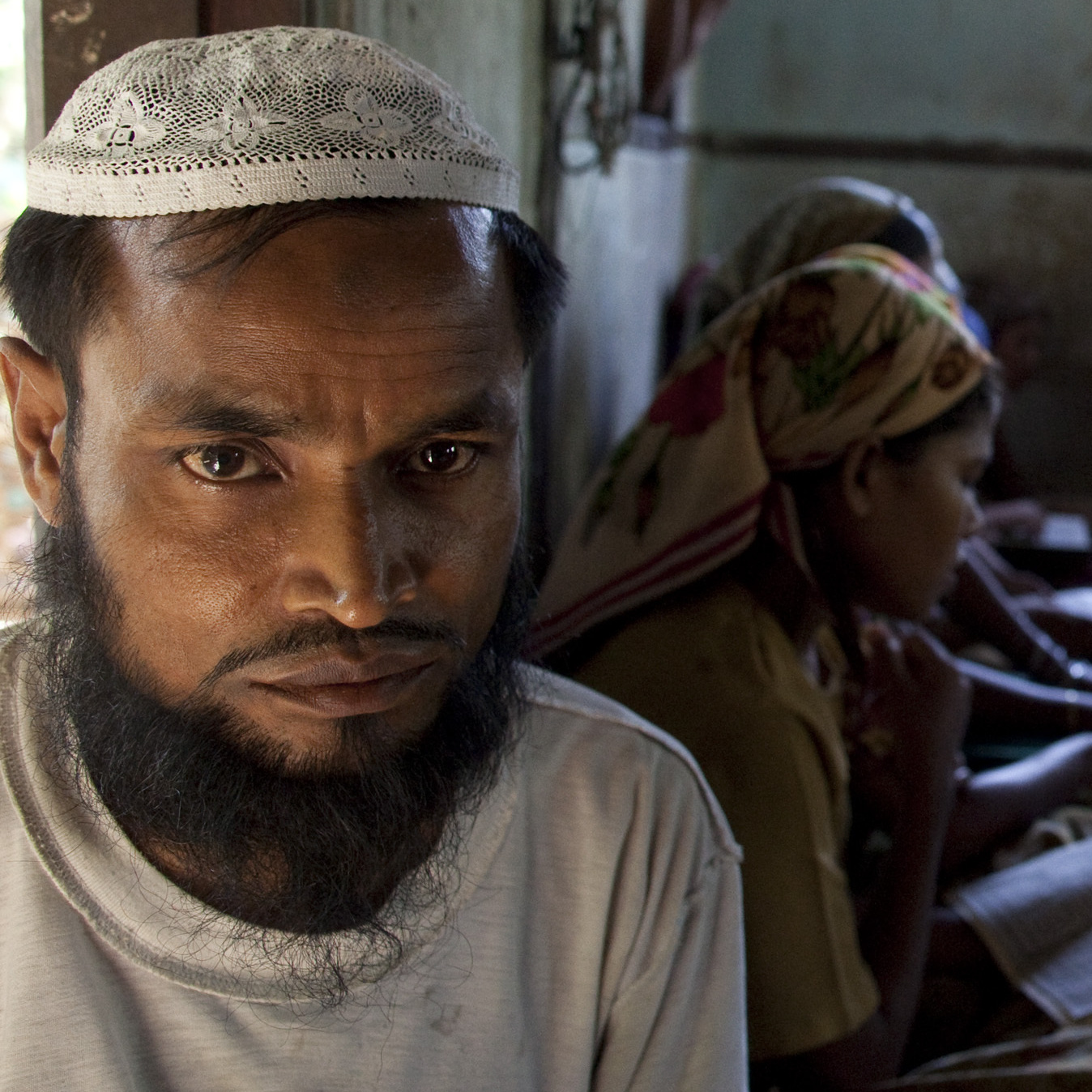 Burmese Rohingya madrassa students read the Quran during religious class on May 4, 2009, in Sittwe, Arakan state, Myanmar.