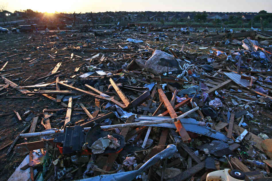 Debris litters a park adjacent to a neighborhood that was destroyed by a tornado in Moore, Okla., on Wednesday. The huge tornado roared through the Oklahoma City suburb, flattening a wide swath of homes and businesses.