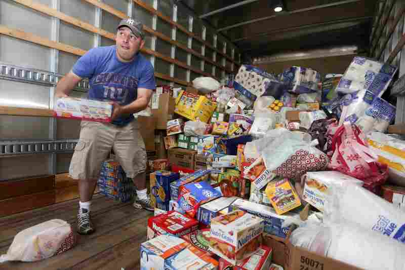 Pastor Roger Murphy unloads a truck full of goods donated by Caliber Collision of Fort Worth, Texas, at OKC Faith Church in Oklahoma City. The goods will be delivered to Feed the Children to be distributed to help the Moore, Okla., tornado victims.