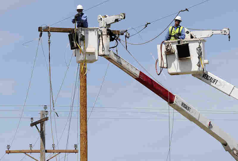 Electric company employees work to restore power in a tornado-devastated neighborhood in Moore. As rescue efforts in wound down, residents turned to the daunting task of rebuilding a heartland community shattered by a vast tornado that killed at least 24 people.