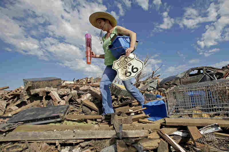 Susan Kates salvages items from a friend's tornado-ravaged home on Wednesday in Moore, Okla. Cleanup continues two days after a huge tornado roared through the Oklahoma City suburb, flattening a wide swath of homes and businesses.