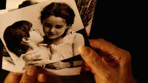 """""""We all look through family albums. We all hear stories at the dinner table. ... They become incorporated into what we believe we actually remember."""" — Scott Fraser"""
