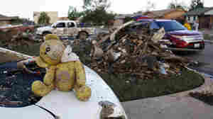 A teddy bear sits atop some of the rubble in Moore, Okla.