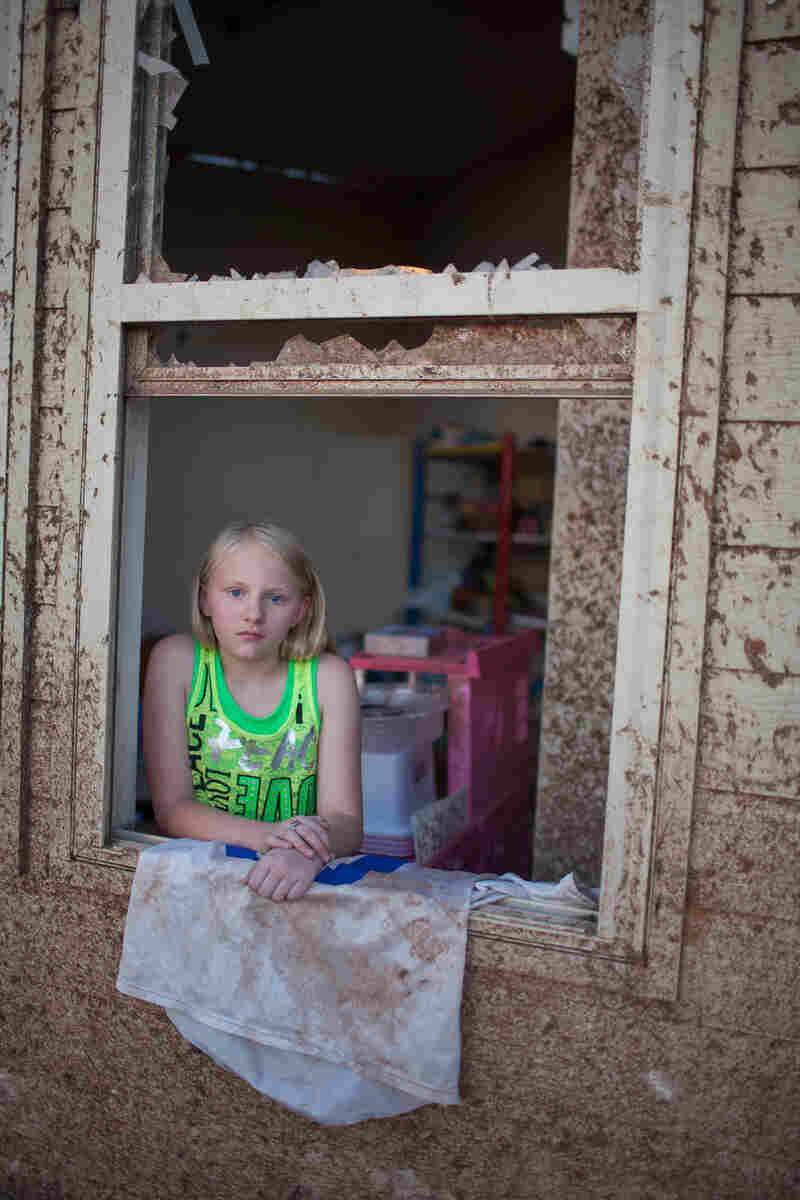 Sara Hock, 11, poses for a portrait in her bedroom window.