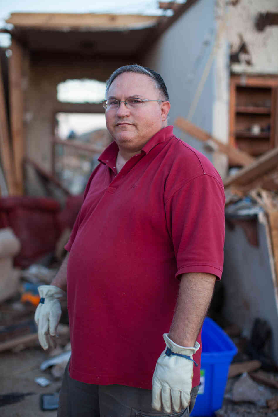 Brian Hock poses for a portrait in what is left of the home he shared with his wife and two daughters in the Heatherwood subdivision of Moore, Okla. They have lived in the 2,000-square-foot home for nine years and aren't sure what they'll do next.