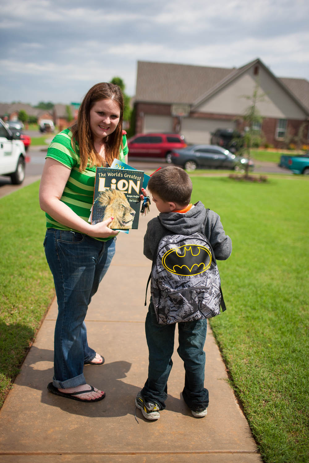 Amber Hill leaves Eastlake with her son Jaren May. Jaren was in the autism program at Plaza Towers and went through the tornado with his teacher and fellow students. Jaren came out Thursday carrying a balloon, a goody bag and a brand-new backpack to replace the one he lost in Monday's tornado.