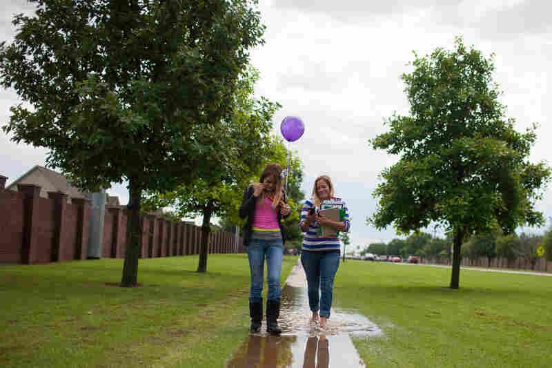 Sixth-grader Mckayla Franks leaves Eastlake Elementary with her mother, Summer Franks.