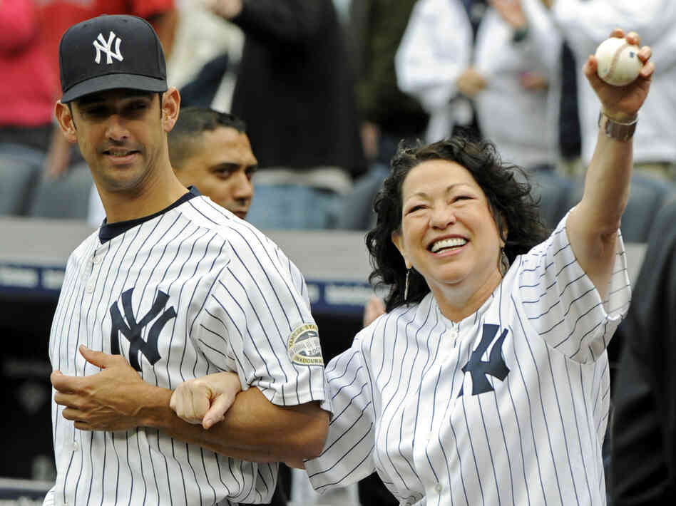Sotomayor is escorted onto the field by New York Yankees catcher Jorge Posada to throw out the ceremonial first pitch before the New York Yankees game against the Boston Red Sox at Yankee Stadium on Sept. 26, 2009.