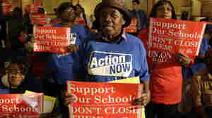 Protesters of Chicago Mayor Rahm Emmanuel's plan to close dozens of city schools rally in the Capitol rotunda in Springfield, Ill., on Wednesday. The Chicago Board of Education voted to close 50 schools.