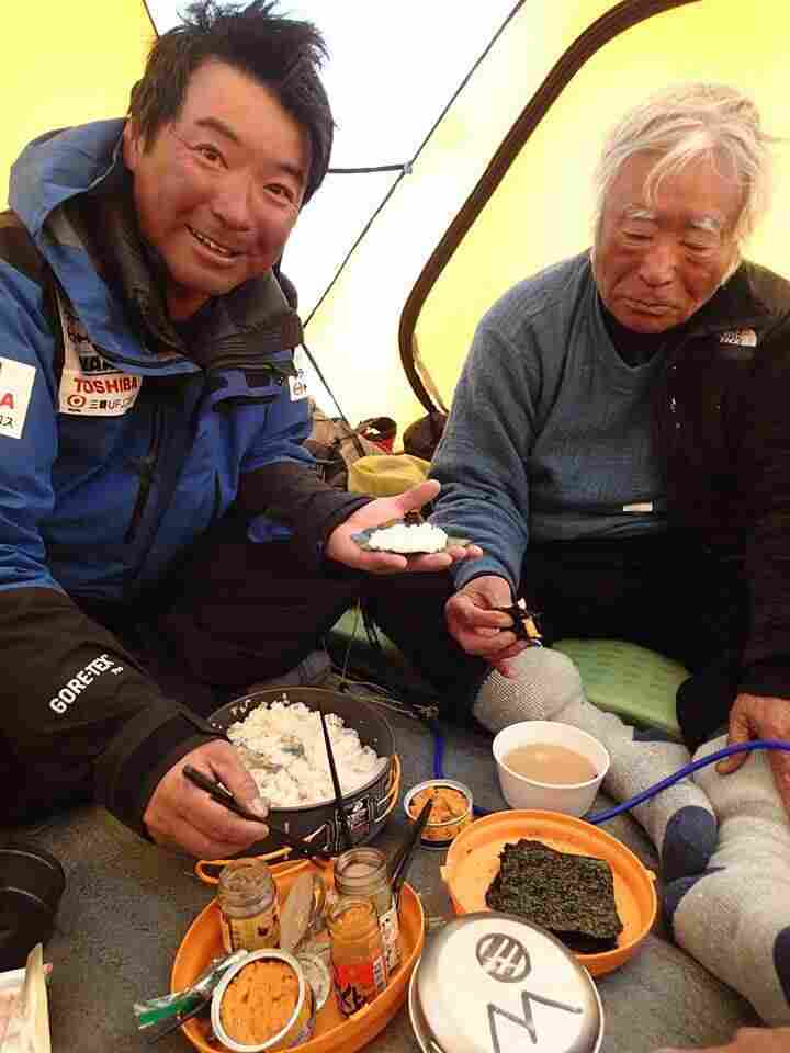 The world's highest sushi bar: On Tuesday, Yuichiro Miura, right, and his son made hand-wrapped sushi on the side of Mount Everest, at the fourth campsite during their climb to the top. The photo won many fans on Facebook.