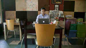 Nay Aung, founder of Oway, a tech startup in Yangon, Myanmar, sits in Taste Cafe, which served as his unofficial office for his first few months in the country. He had to start his business here because it was one of the few places with a stable Internet connection.