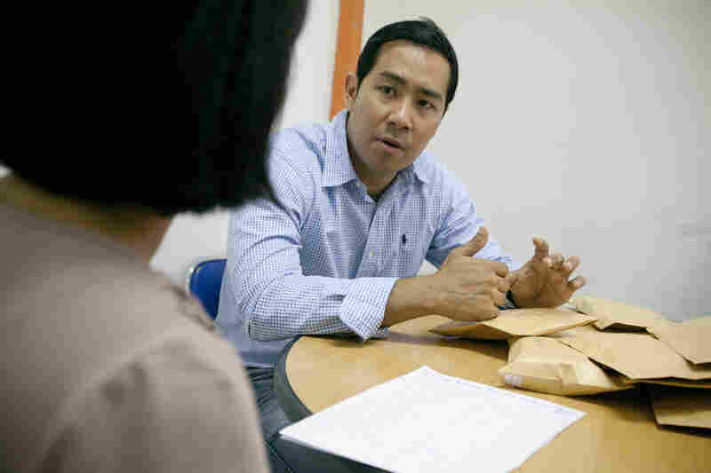 Aung gives one of his employees feedback during a monthly meeting. Giving regular feedback is one of the management techniques he brought from Silicon Valley to Myanmar. After the meeting, he hands his employees thick envelopes that contain their salaries in cash. Even though Nay eventually hopes to develop online and mobile payment services, most of his employees prefer to be paid in cash.