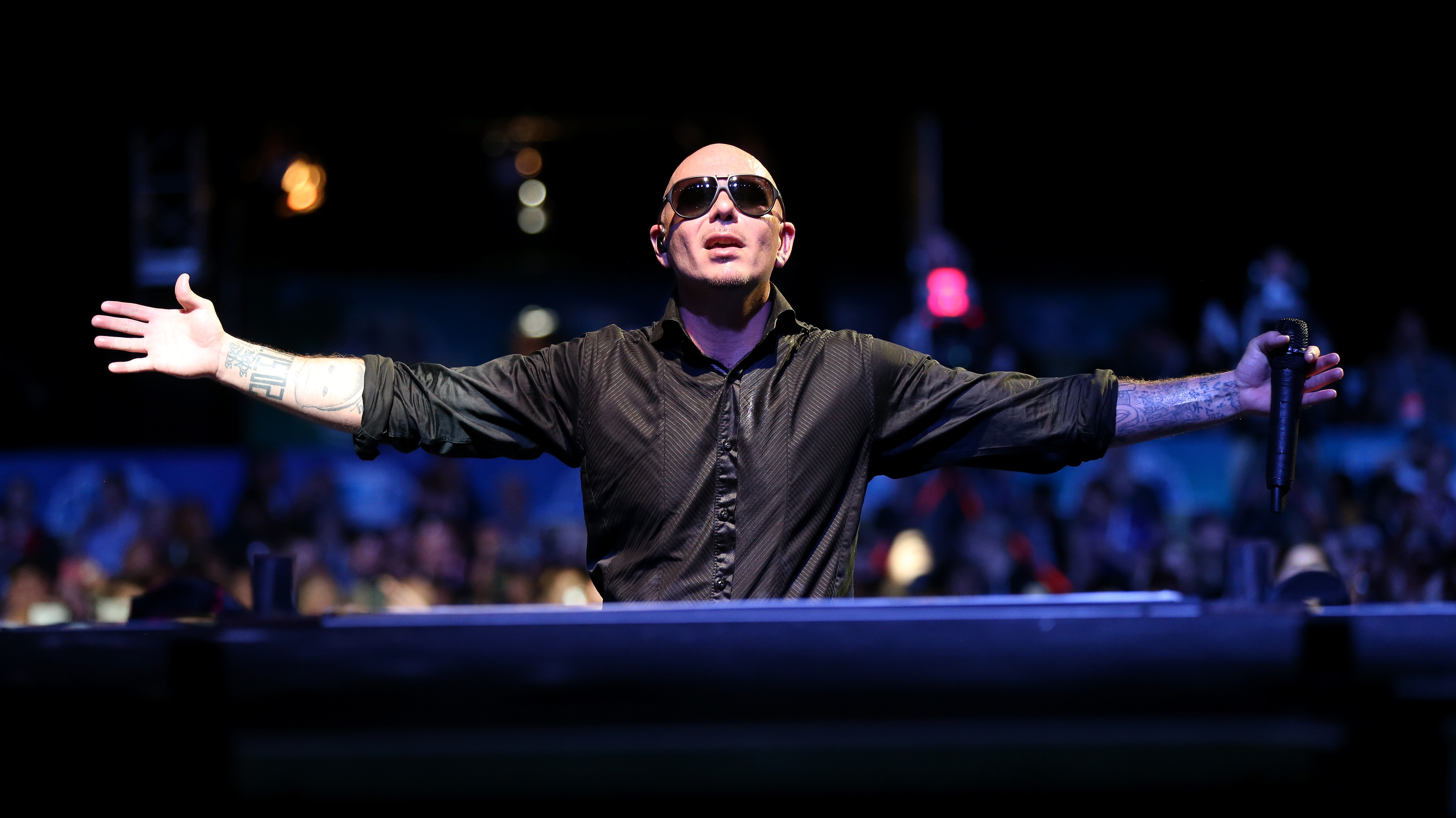 Pitbull Gets 'Epic': 'You Constantly Have To Defend Your Success'
