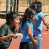 An elementary school student enjoys Field Day on a playground. Harold Begay, superintendent of the Tuba City Unified School District in Arizona, says the repairs that are needed to playground equipment, school buildings and buses would no€™t be allowed anywhere else.