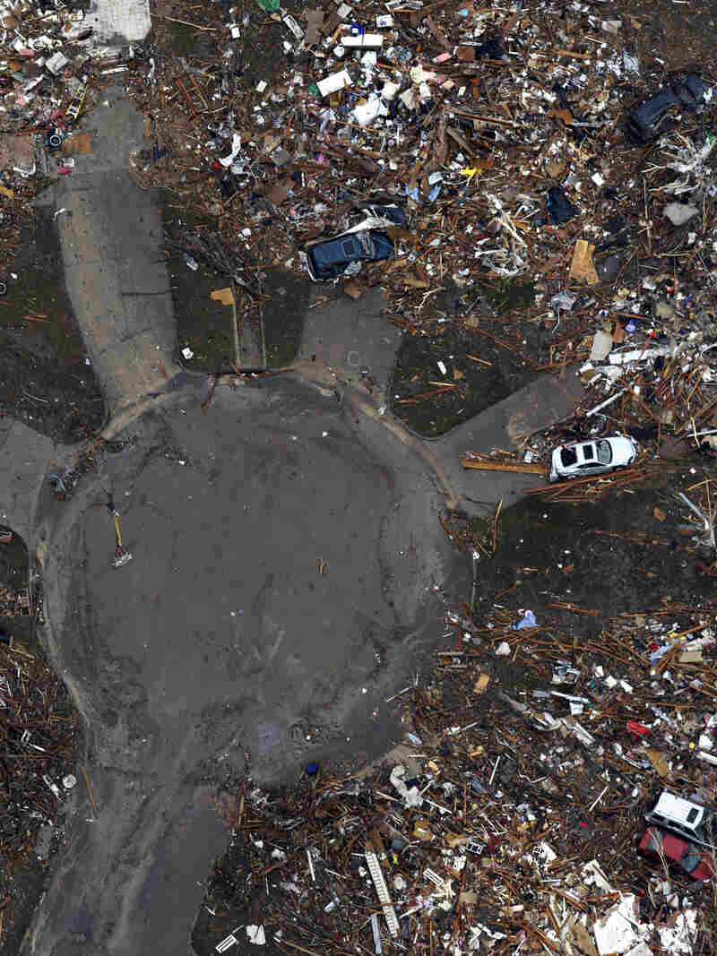 An aerial photo shows destroyed houses in Moore, Okla., after Monday's tornado. Rena and Paul Phillips, who lost their home in the storm, also lost a house to a tornado in 1999.