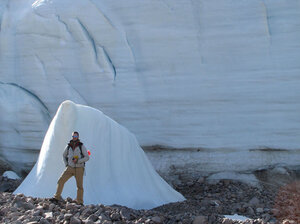 As the Teardrop Glacier on Ellesmere Island in the Canadian Arctic recedes, researchers have found a kind of evergreen plant called bryophytes coming out from beneath the ice. Here, a researcher stands next to part of the glacier for scale.