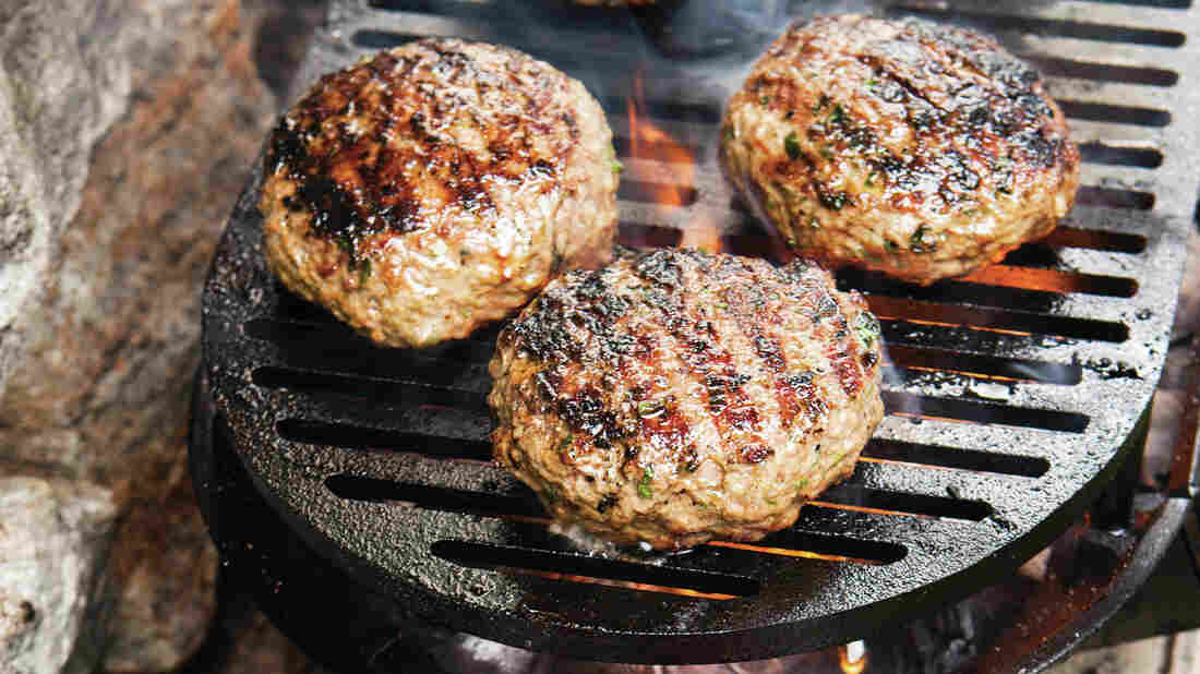 Bon Appetit editor Adam Rapoport compiled recipes from all over the world for The Grilling Book. Pictured here are Lamb Burgers with Moroccan Spices.