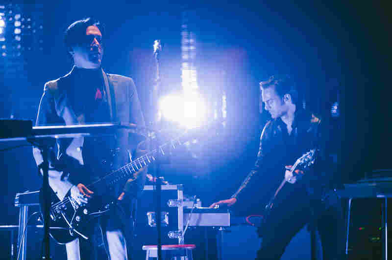 Michael Shuman (bass guitar, backing vocals) and Dean Fertita (keyboards, guitar, backing vocals).