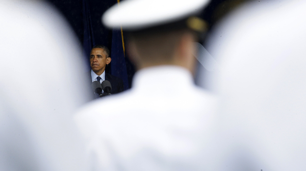 President Obama speaks at the commencement ceremony for the United States Naval Academy in Annapolis, Md., on Friday. The president urged new graduates to exhibit honor and courage in tackling incidents of sexual assault as they assume leadership positions in the military. (AP)