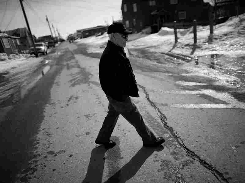 """Laban Iyatunguk, who served in the ATG, or """"Eskimo Scouts,"""" walks away from the Veterans of Foreign Wars hall in Nome, where VA officials from Washington, D.C., were trying to register ATG vets. Iyatunguk says he has waited years to take advantage of his VA benefits but found the application process too daunting."""