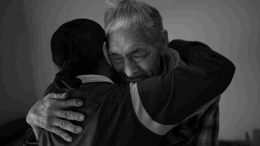 Frankie Kuzuguk, 82, gets a hug from his daughter Marilyn Kuzuguk at Quyanna Care Center in Nome, Alaska, after receiving an official honorable discharge and a distinguished service coin from visiting Veterans Affairs officials. The VA is still tracking down the few surviving members of the World War II Alaska Territorial Guard or delivering benefits to their next of kin.