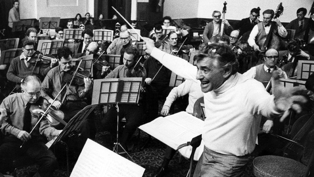 """Leonard Bernstein leads the London Symphony Orchestra. He called Stravinsky's famously savage Rite of Spring """"extremely tuneful and dancy, rhythmically seductive, beguiling."""" (Getty Images)"""