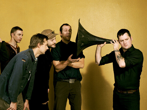 Modest Mouse frontman Isaac Brock uses a massive ear trumpet to really listen.