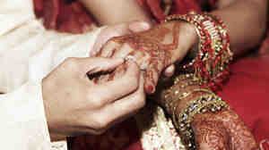 A bride and groom exchange rings during a traditional Indian wedding ceremony. Although most marriages in India are still arranged, a growing number of women are taking matters of the heart into their own hands, using social networking clubs and matrimonial websites.