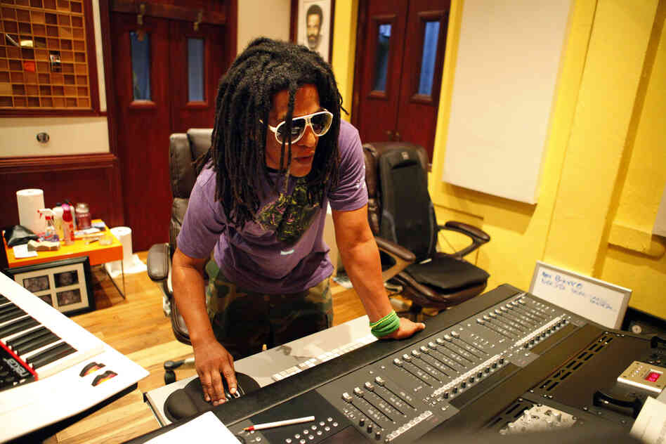 Puerto Rican hip-hop artist Tego Calderón is seen in his studio, El Sitio, in Santurce, San Juan, Puerto Rico. Behind him, a portrait of Ismael Rivera.