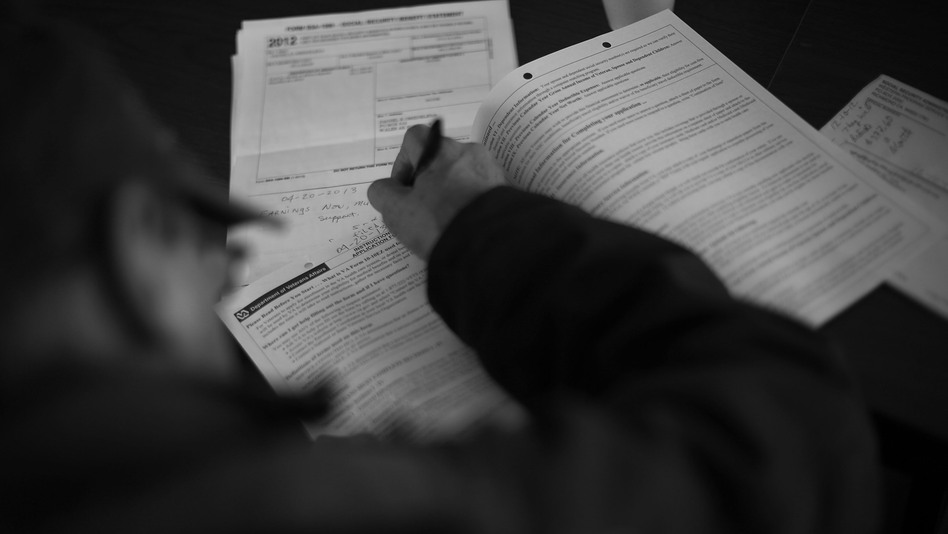 Isaac Oxereok, 69, fills out the papers needed to register for full VA care and benefits. Oxereok was in the Army and served in Vietnam from 1966-67.
