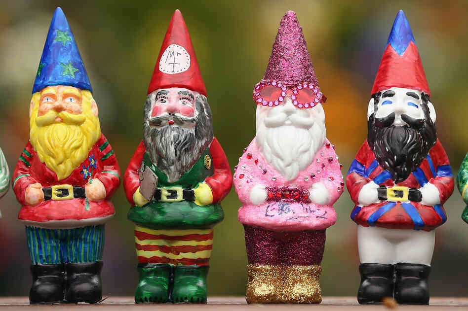 Decorated gnomes designed by celebrities, including Elton John (his gnome is second from the right), are featured at the Chelsea Flower Show in London