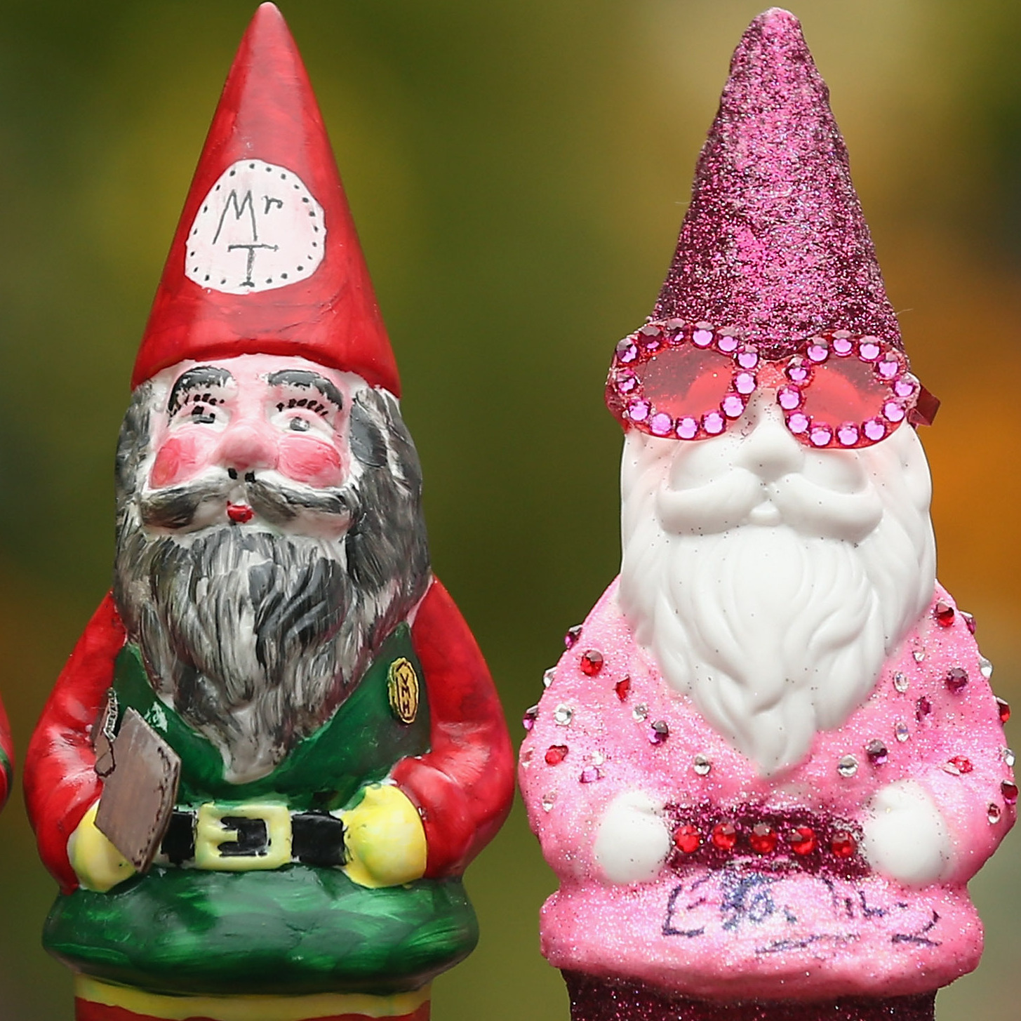 Decorated gnomes designed by celebrities, including Elton John (second from the right), are displayed at Chelsea Flower Show on Monday in London.