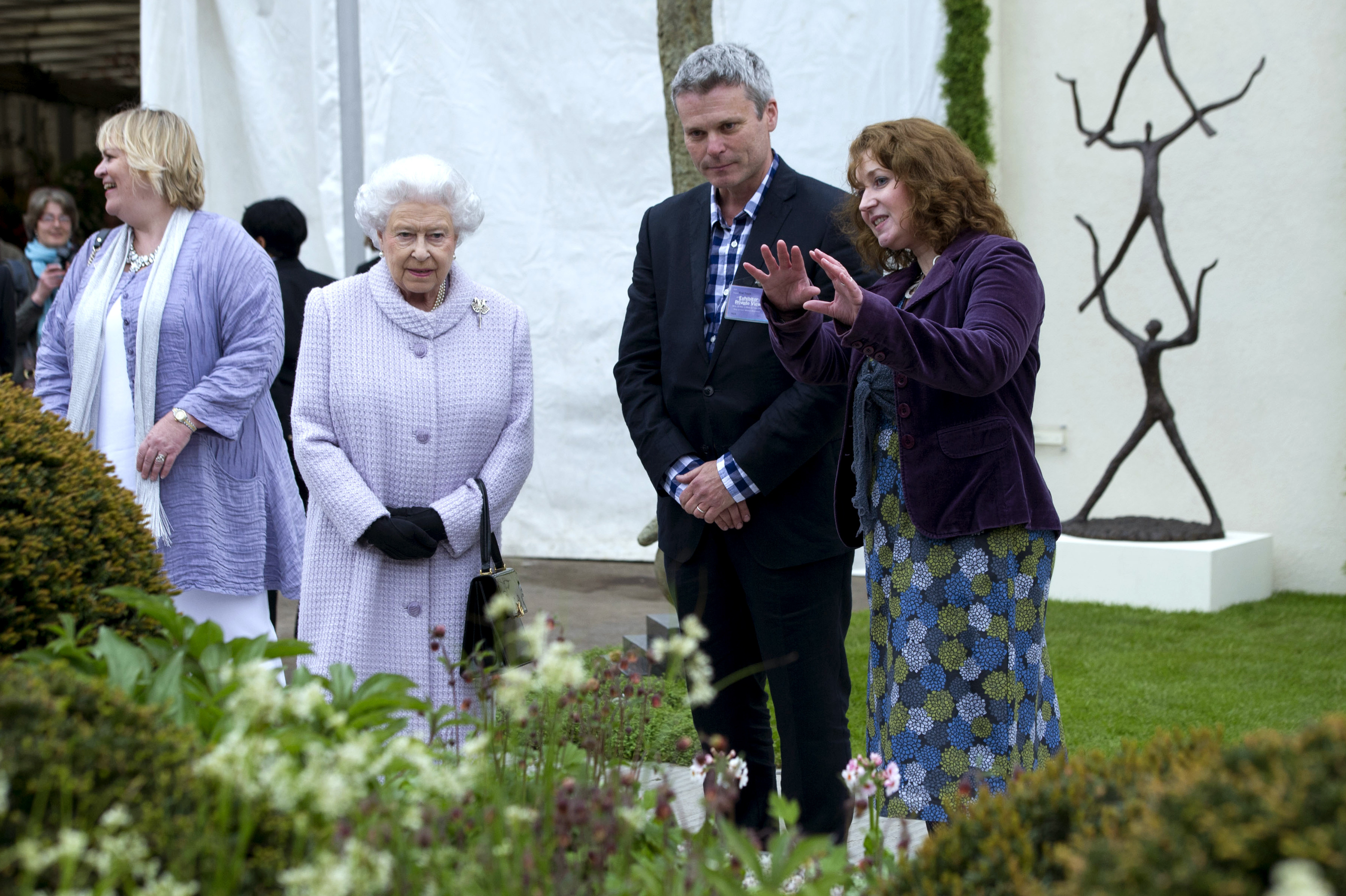 Queen Elizabeth II meets award-winning garden designers Patrick and Sarah Collins at their First Touch Garden.