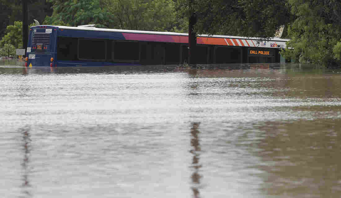 A San Antonio metro bus sits in floodwaters after it was swept off the road during heavy rains on Saturday.
