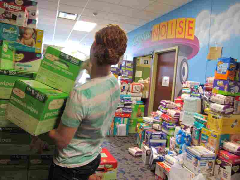 JourneyChurch in Norman, Okla., is packed with donations, including a wall of diapers.